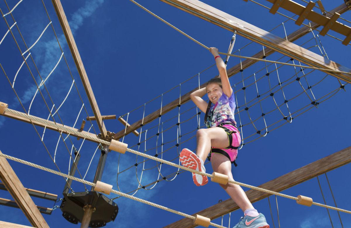 A child climbing at Sky Ropes