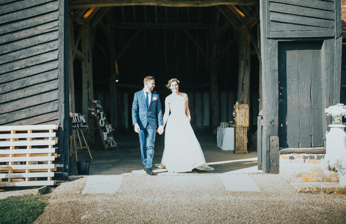 The bride and groom leaving the barn