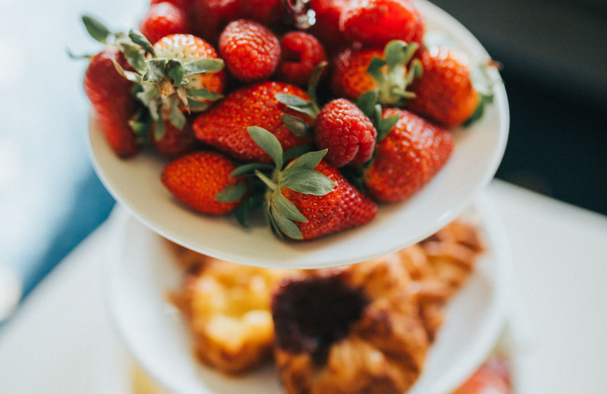 Fresh fruit and pastries on a cake stand