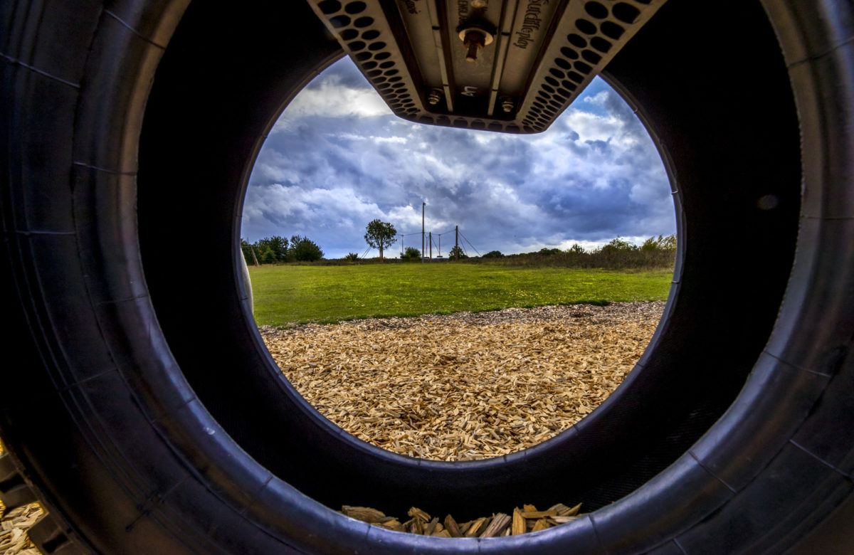 A shot through a tyre at a playground