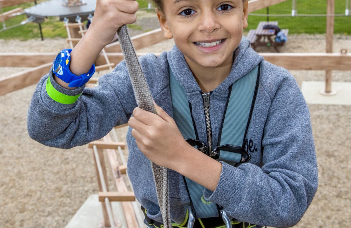 A boy using Sky Ropes