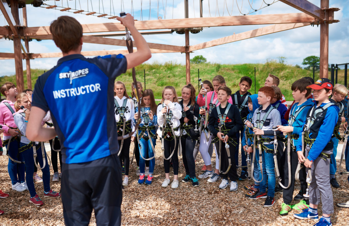 An instructor briefing children at Sky Ropes