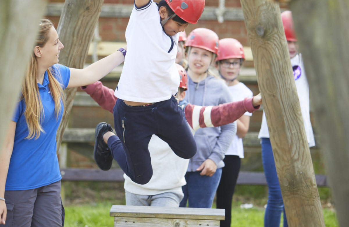 Children swinging on an obstacle course