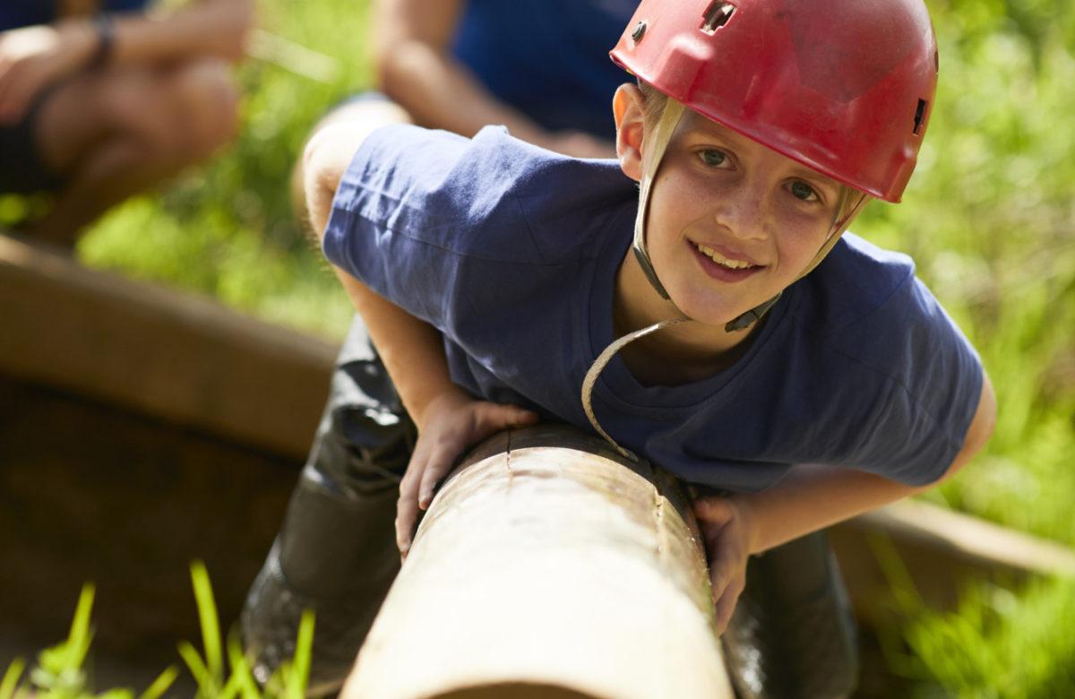 A child climbing on a log