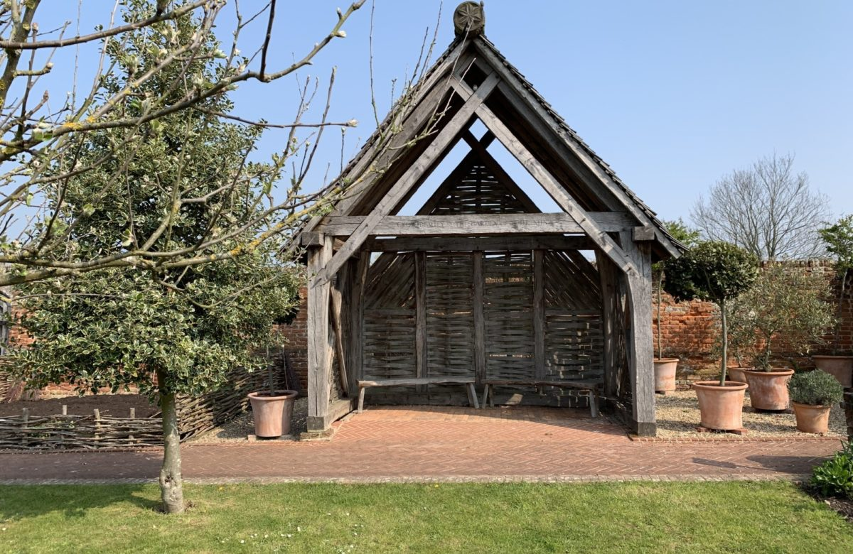 A small wooden shelter with seating