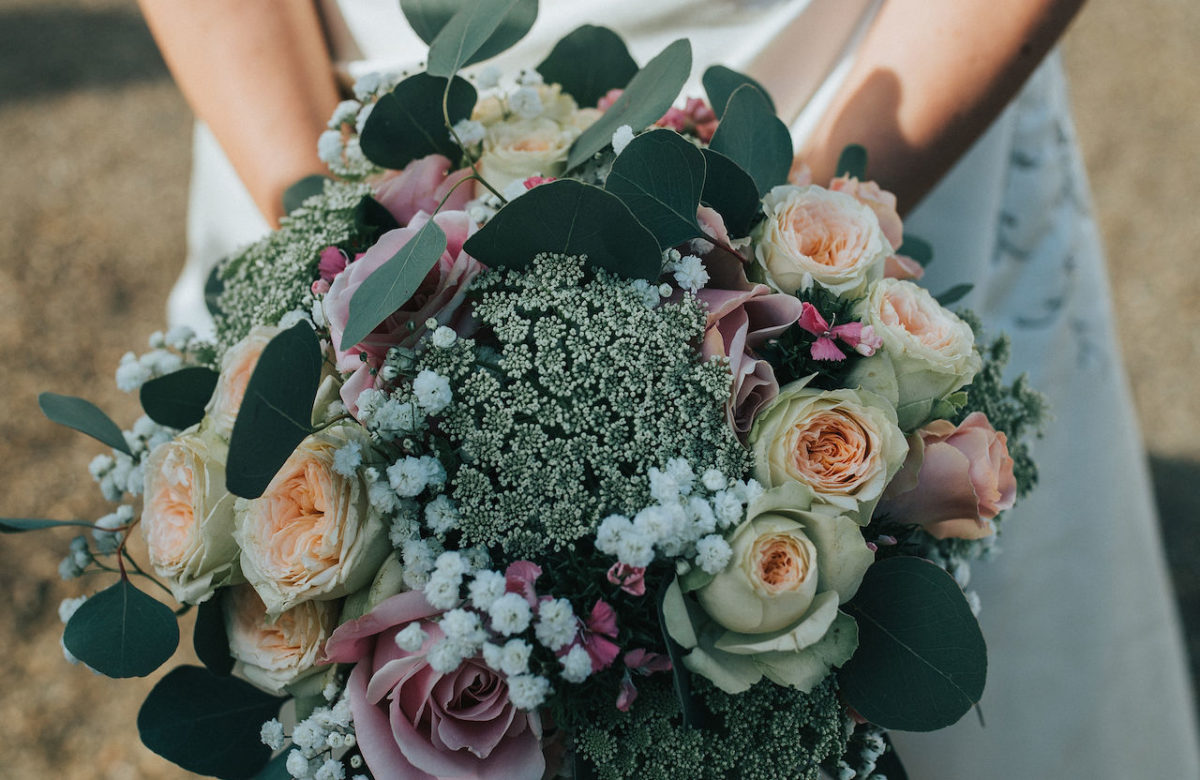 The bride holding a bouquet of flowers