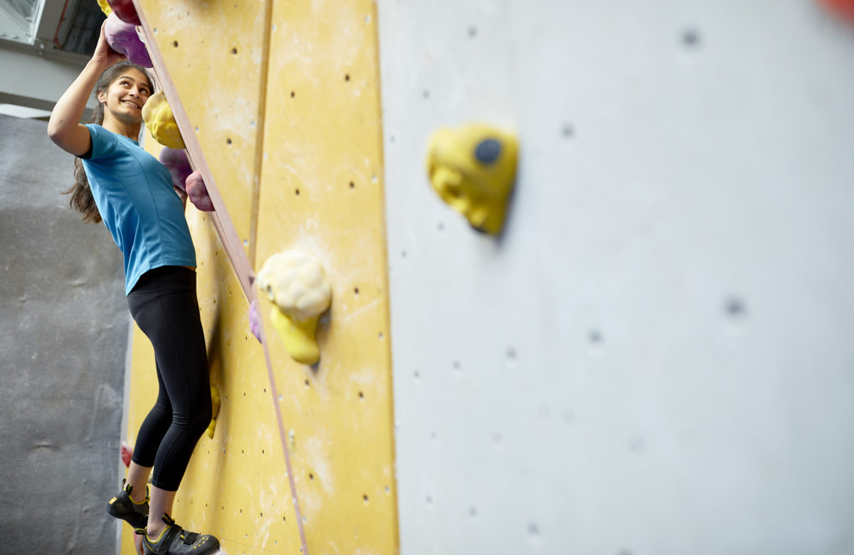 A lady on a climbing wall