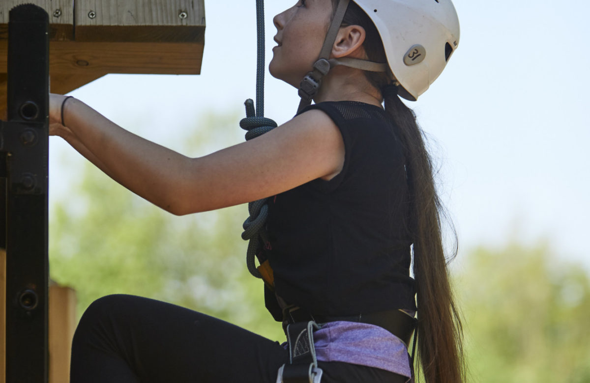 A young girl climbing