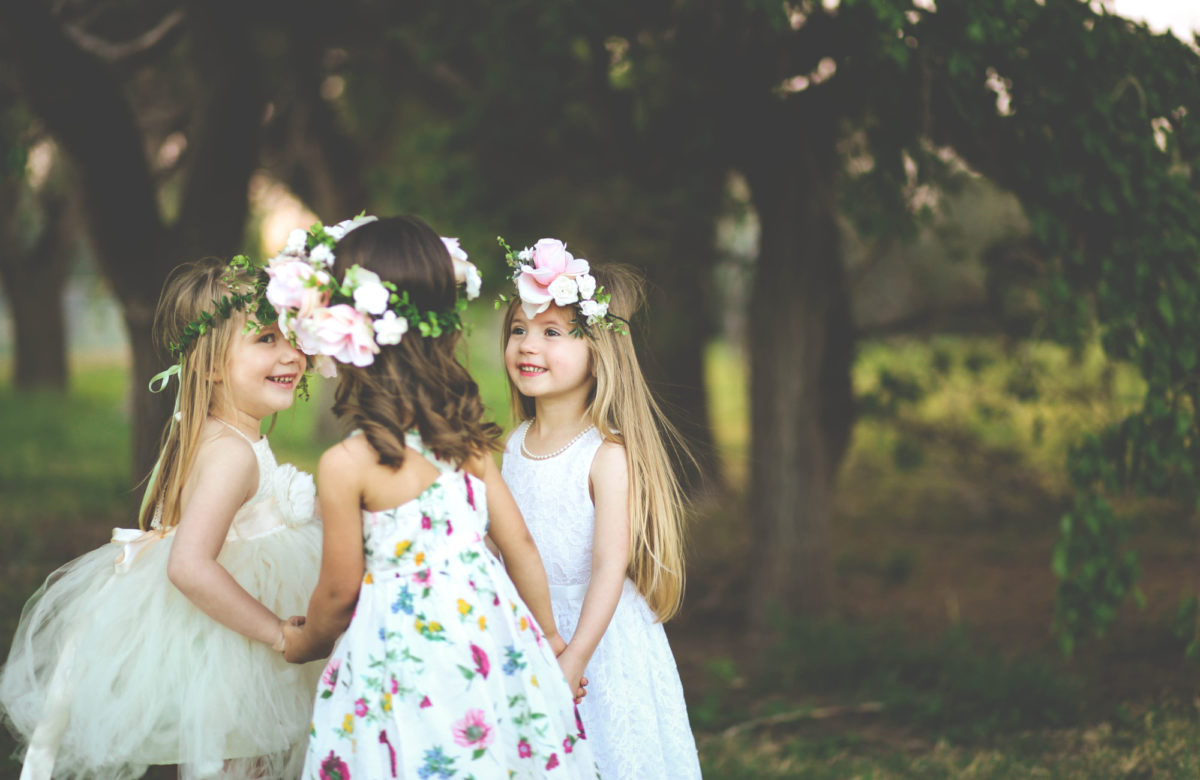 Children holding hands at a wedding