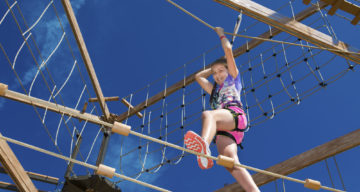 A child climbing at Sky Ropes