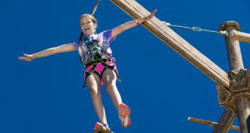 A girl balancing at Sky Ropes