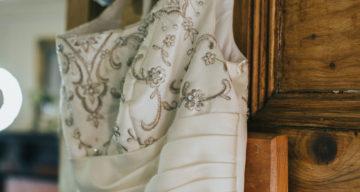 Wedding dress hanging on a door