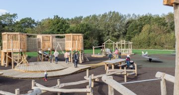 People enjoying an outdoor adventure playground