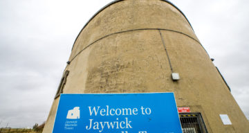 A sign welcoming visitors to Jaywick Martello Tower