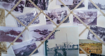 Old photographs displayed on a wall