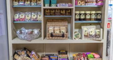A bookshelf displaying products for sale