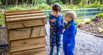 Children exploring a bug hotel