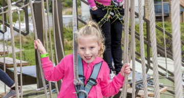 A girl and a lady using Sky Ropes