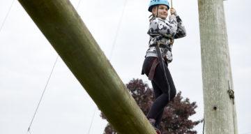 A girl balancing on a log
