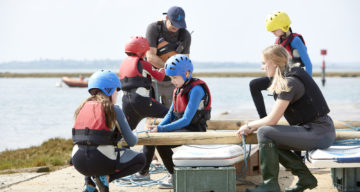 A group of people building a raft