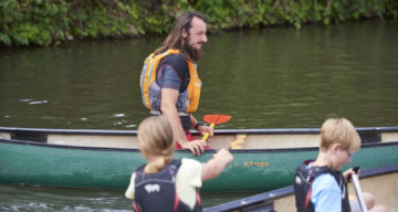 Children and adults canoeing