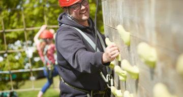 A man on a climbing wall
