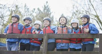 A group of children in climbing gear