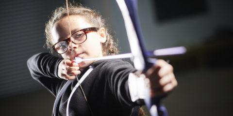 A girl doing archery