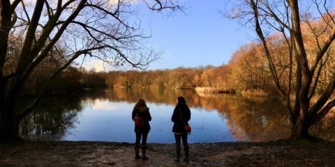 People standing by lake in winter Sophie F