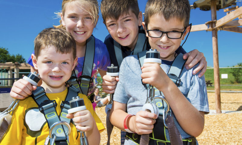 Young children in Sky Ropes harnesses